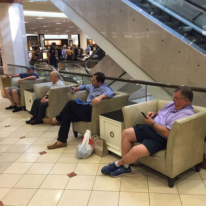 Funny Husband Waits For Shopping Wife At The Mall