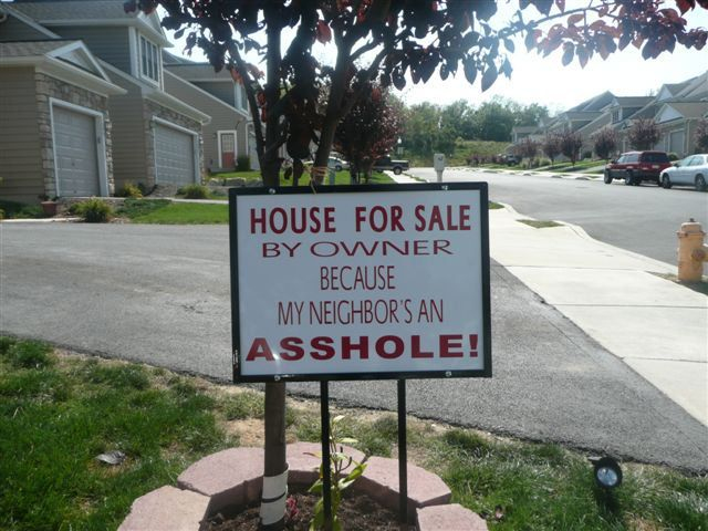 Funny Sign house for sale by owner because my neighbor